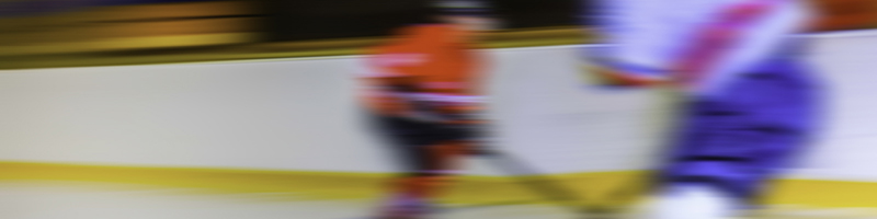Sports Coach image - Two ice hockey players in action, blurred motion.