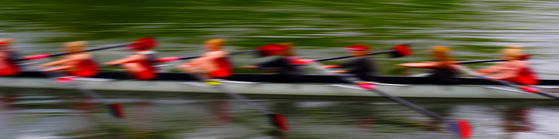 Coaching image - A team of eight racing in a rowing boat on the river Wear in Durham, England.